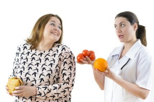 Doctor telling woman what to eat