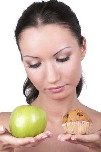 Woman apple-cupcake decision
